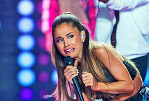 Ariana Grande looking scared